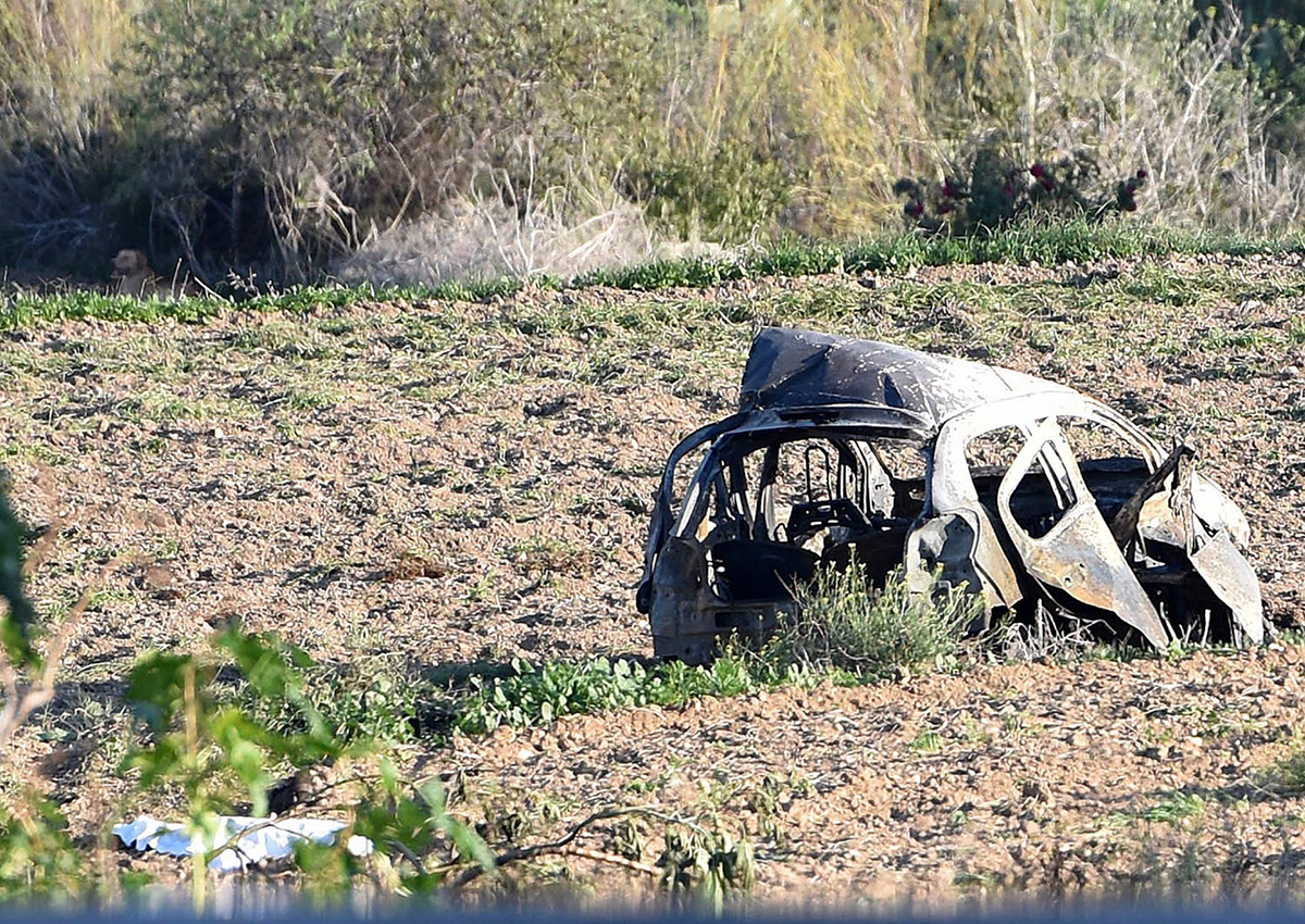 The wreckage of the car of investigative journalist Daphne Caruana Galizia lies next to a road in the town of Mosta, Malta, Monday, Oct. 16, 2017.