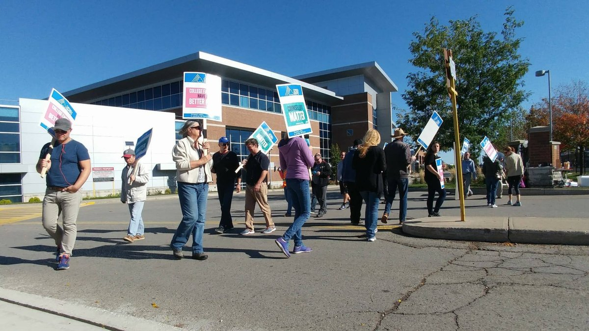 Faculty at Fanshawe College walk the picket line at the entrance in front of T building on Oxford St. E.
