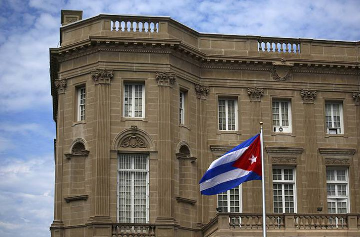 The Cuban national flag is seen raised over their embassy in Washington, DC, on July 20, 2015.