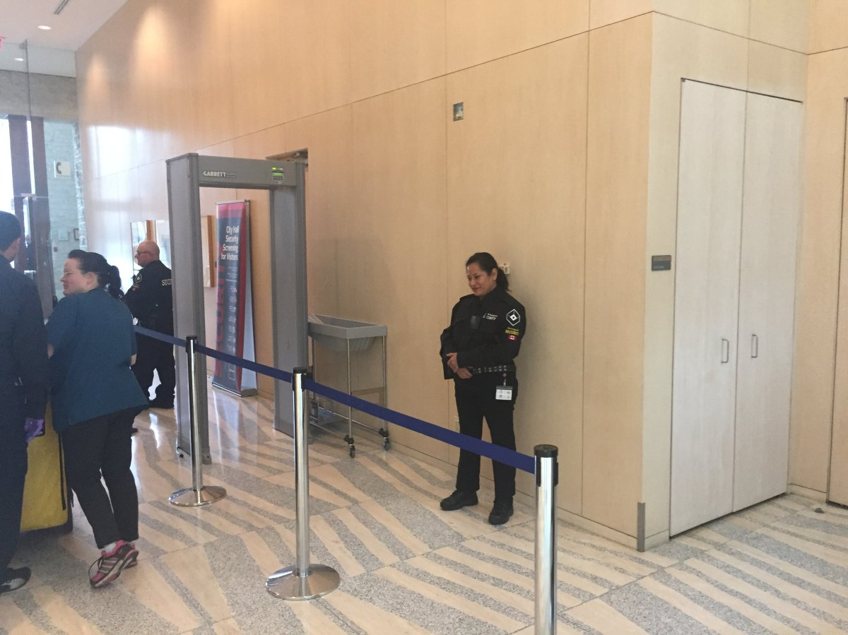 A metal detector is part of the new security measures at Edmonton City Hall.
