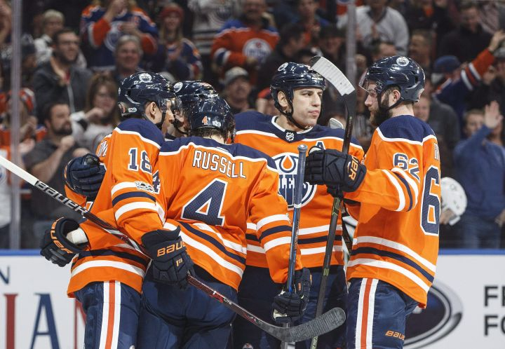 Edmonton Oilers players celebrate a goal against the Dallas Stars during second period NHL action in Edmonton, Alta., on Thursday October 26, 2017.
