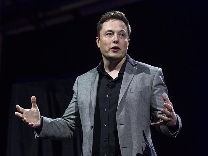 In this April 30, 2015 file photo, Tesla Motors CEO Elon Musk speaks in Hawthorne, Calif.