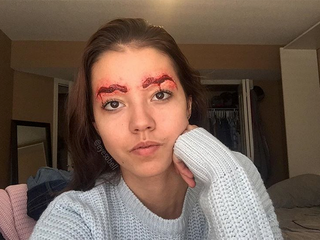 This year has seen a number of new eyebrow trends, but makeup artist Eyesobell's version of bloody squiggle brows may take the cake.
