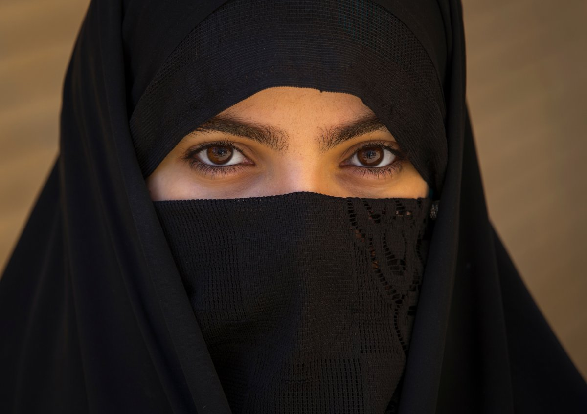 A woman wears a niqab.