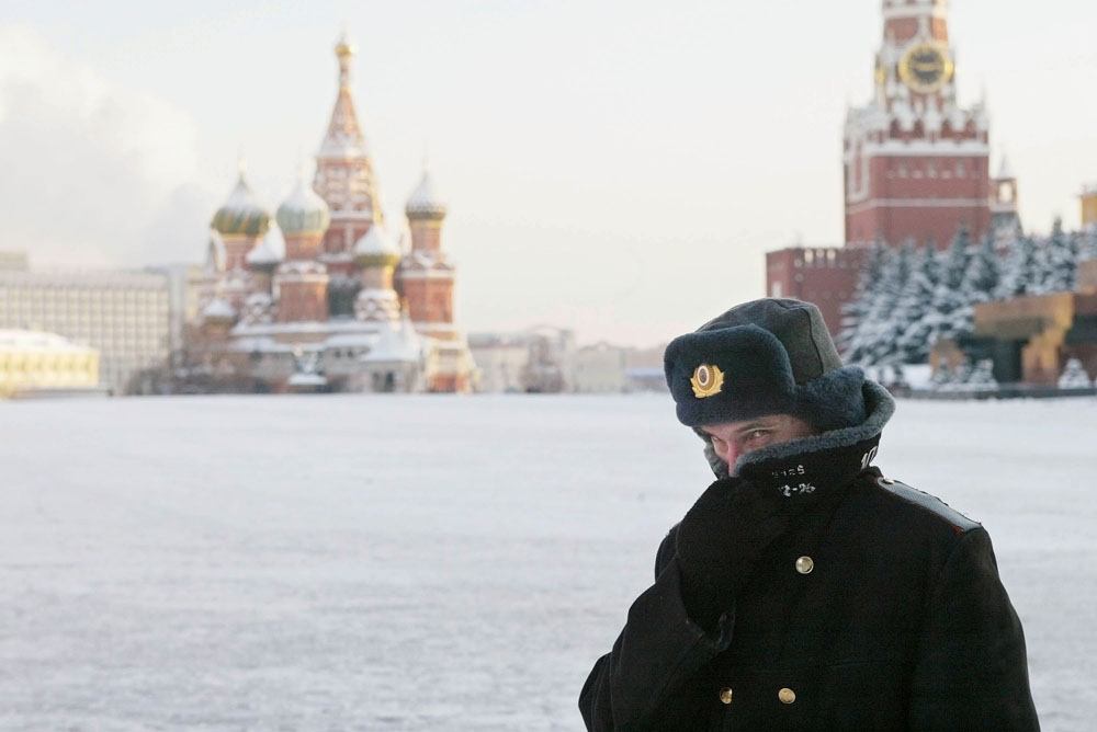 A Russian police officer, braving the bitter cold, patrols Red Square with the Kremlin in the background in this file image.