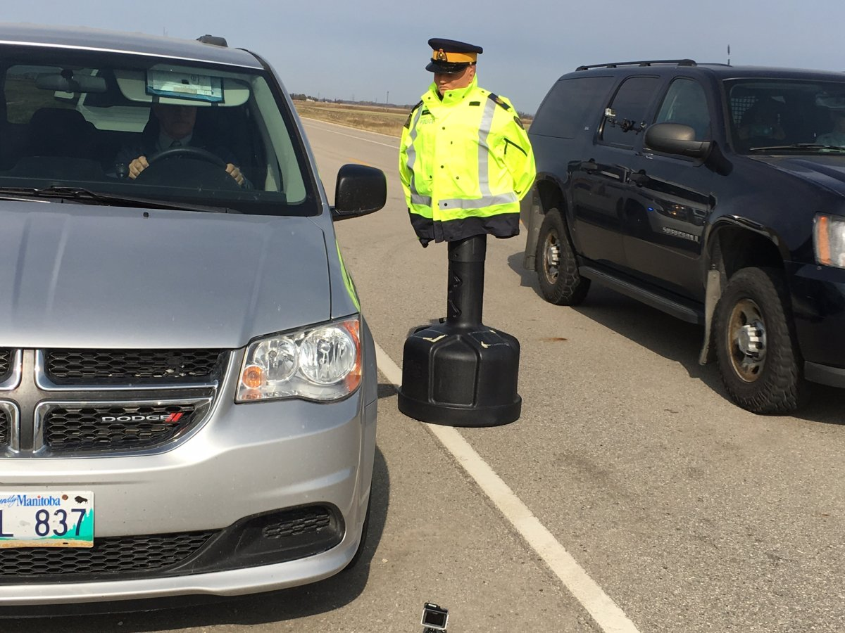 Manitoba RCMP held a road-side simulation of safety officers on a traffic stop Oct. 12.