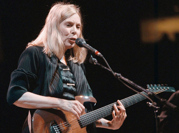 Folk singer Joni Mitchell plays to a sold out crowd at General Motors Place in Vancouver in 1998. Author David Yaffe first encountered JoniMitchell about a decade ago and it didn't take long before he fell on her bad side.