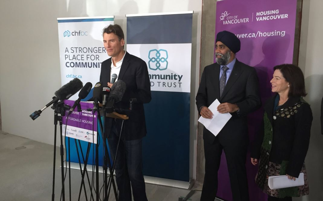Vancouver Mayor Gregor Robertson alongside Minister Harjit Sajjan and Minister Selina Robinson announce opening of first land trust building.