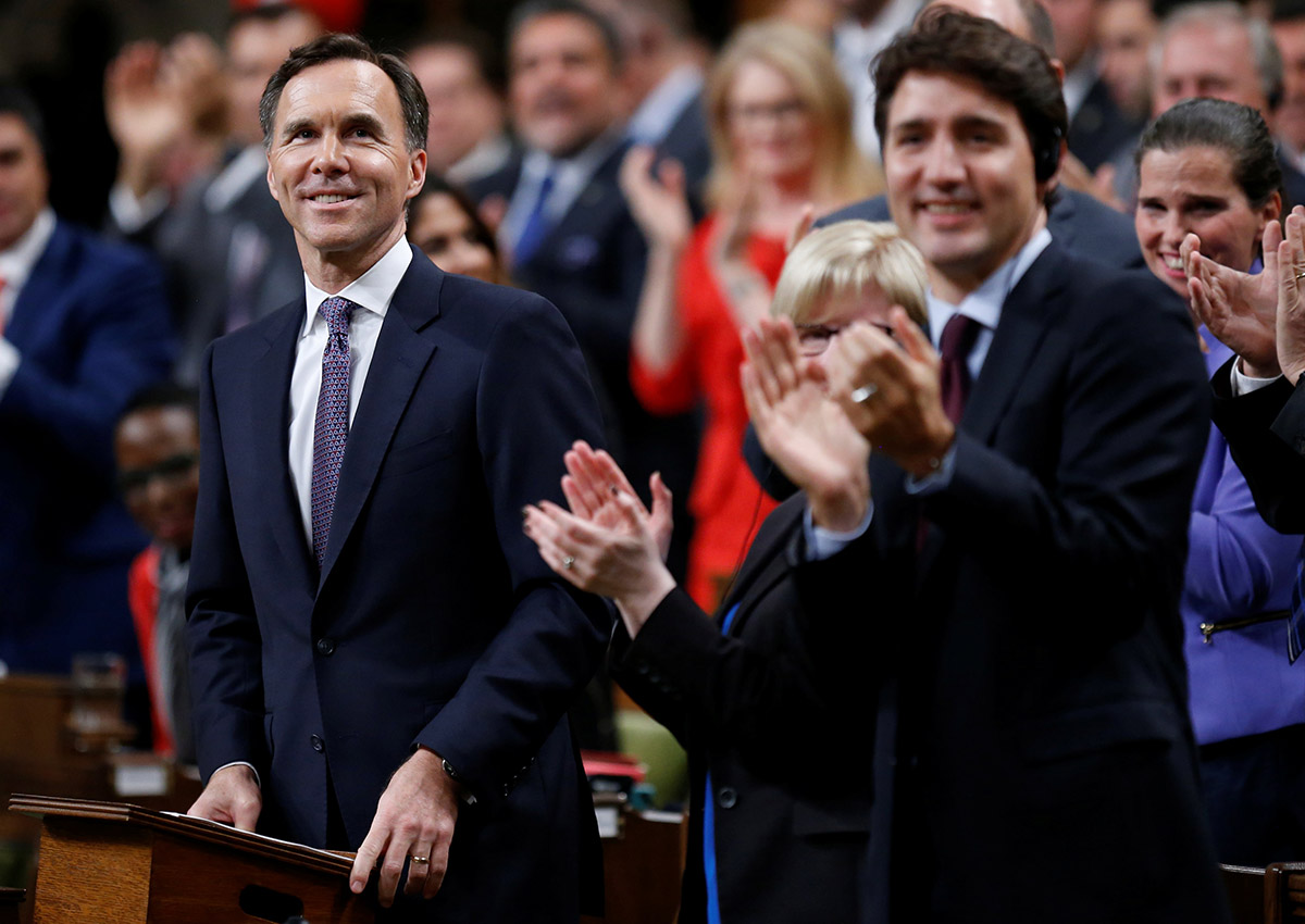 Canada's Finance Minister Bill Morneau receives a standing ovation before delivering the Fall Economic Statement in the House of Commons on Parliament Hill in Ottawa on Oct. 24, 2017.