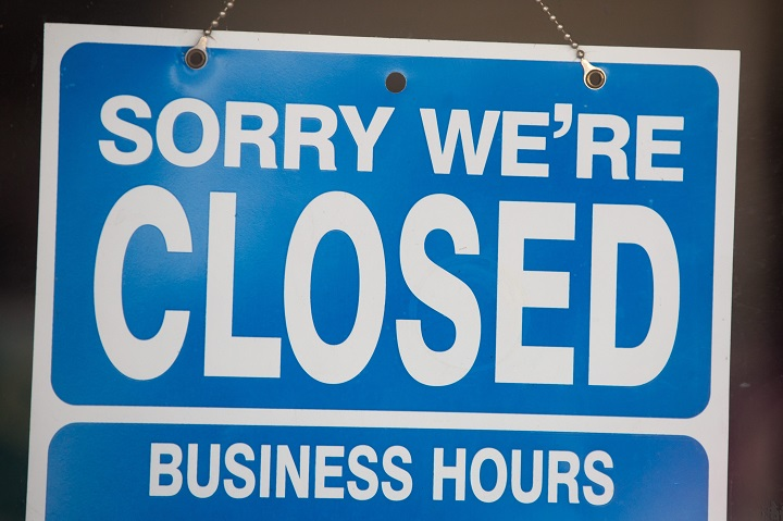 This file photo shows a closed sign.