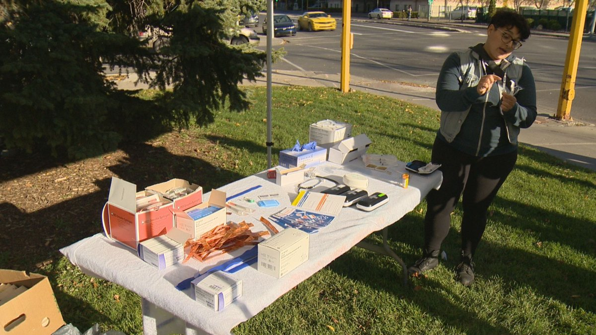 A group set up a mock safe injection site outside Regina's city hall on Wednesday to educate the public about their benefits.