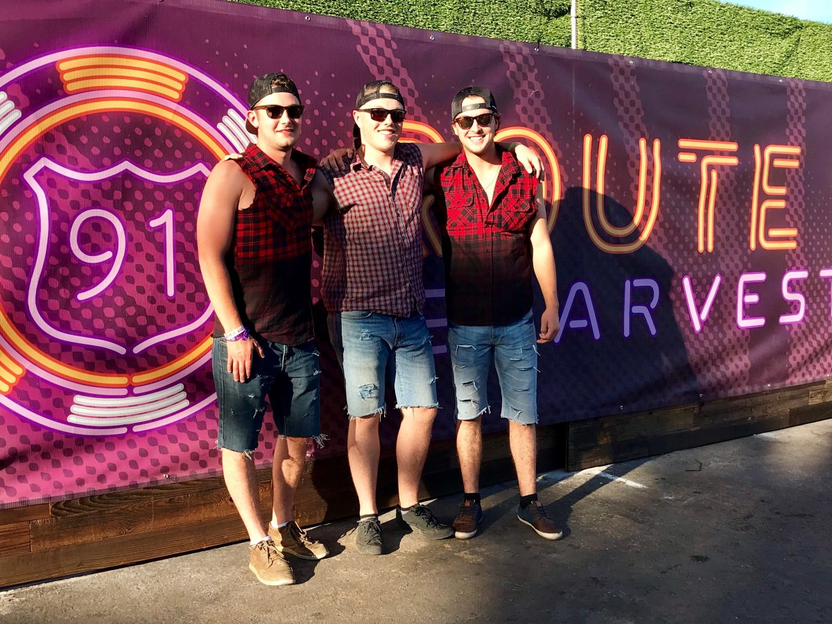 Cole Rennie, Kyle Welsh, Michael Sampson pose outside the Route 91 Harvest Festival just hours before Sunday's deadly shooting.