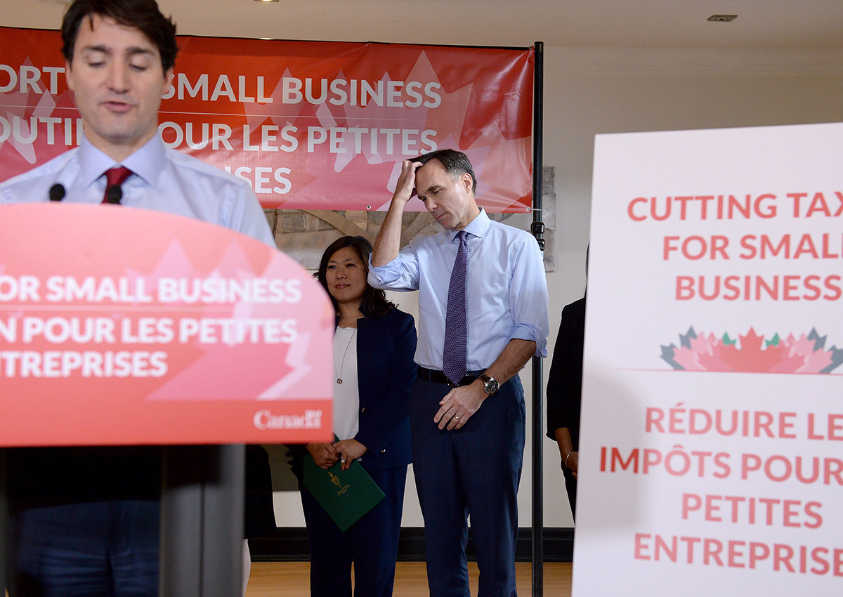 Finance Minister Bill Morneau looks on as Prime Minister Justin Trudeau speaks to members of the media at a press conference in Stouffville, Ontario,.