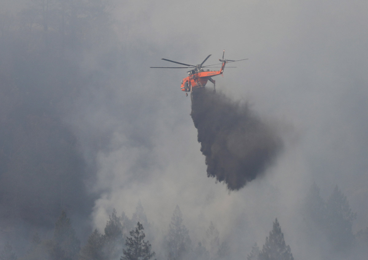 Firefighting helicopters work to contain a wildfire near Oakville, California, U.S., October 16, 2017.