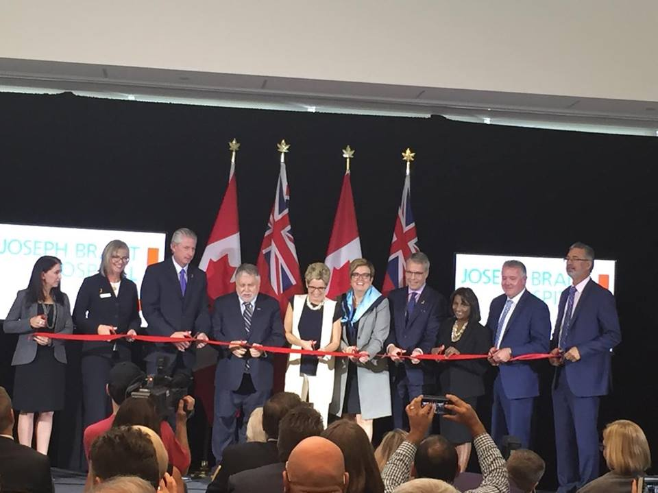 Premier Kathleen Wynne cuts ribbon at grand opening of the new Michael Lee-Chin and Family patient centre at Joseph Brant Hospital.