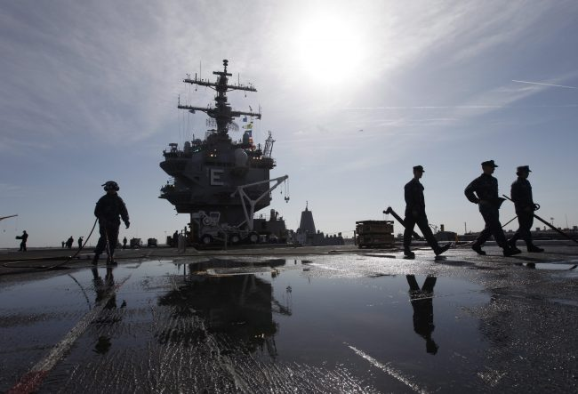 Sailors prepare for the deployment of the nuclear aircraft carrier USS Enterprise at the Norfolk Naval Station in Norfolk, Va., March 8, 2012.
