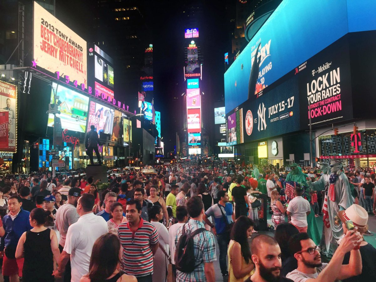 In this Saturday, July 16, 2016, photo, crowds of visitors linger in New York's Times Square - one of El Bahnasawy  intended targets.