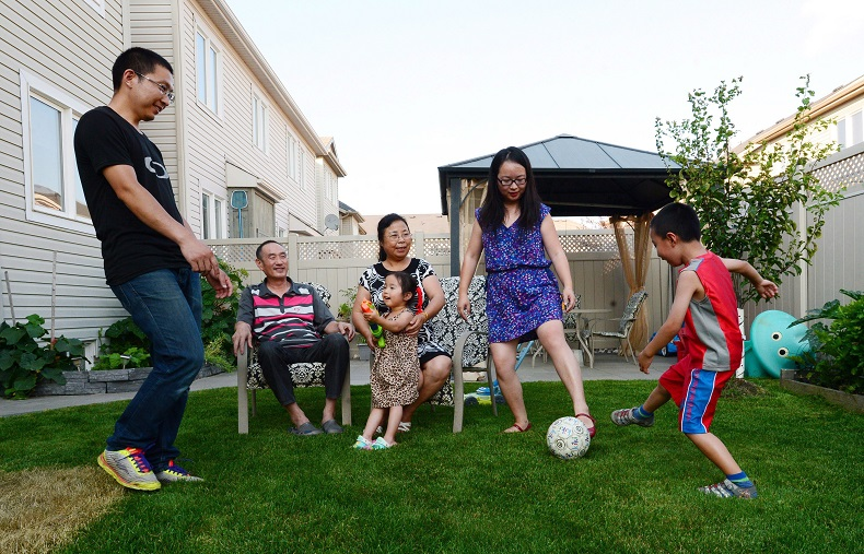 Yi Jiang, Jianqiao Sun, their son Sunny, their daughter Jenny and grandparents Youfang Jiang and Li Zhang are pictured at their home in Ottawa in July. The family immigrated to Canada from China and live together as a multi-family household.