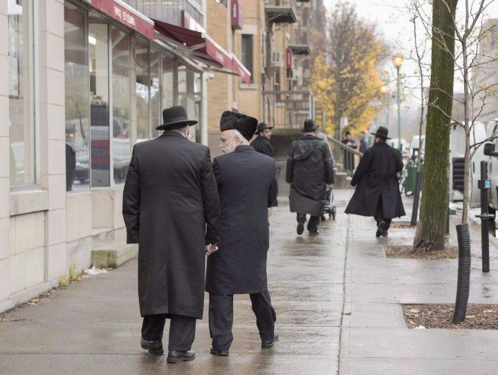 Hasidic Jewish men walk along Bernard Street in Outremont, in Montreal on Nov. 16, 2016.