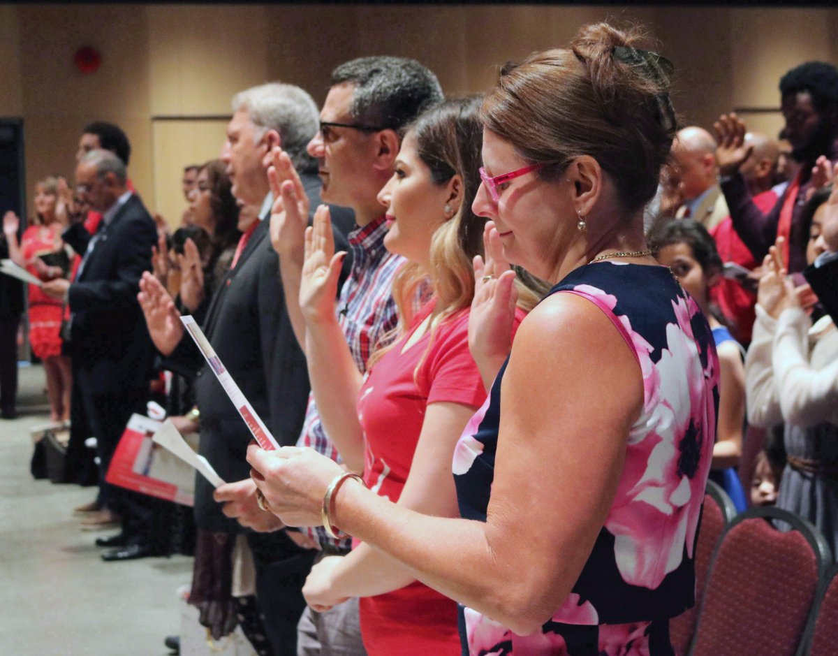 People take the citizenship oath at Pier 21 immigration centre in Halifax on July 1, 2017.