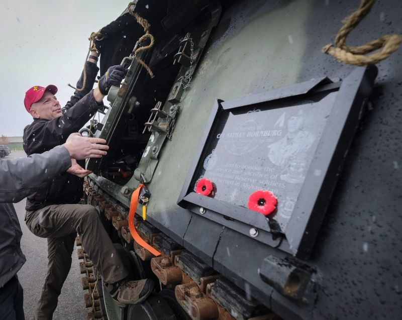 Canadian Forces veteran John Senior works on de-commissioned armoured vehicle in Calgary, Alta., Wednesday, Oct. 11, 2017.