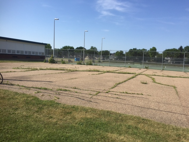 The Allendale Community League wanted to turn this unusable asphalt pad into a community garden.