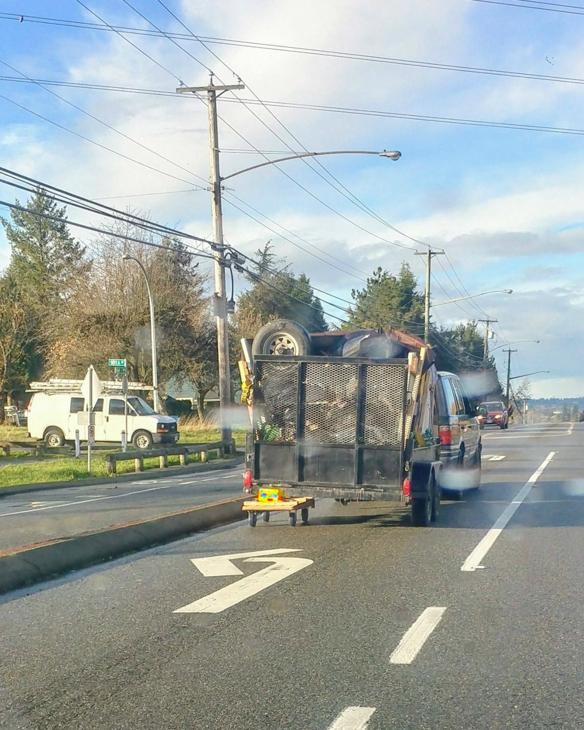 A trailer that appeared to have a dolly replacing its left wheels in Surrey on Nov. 16, 2017.