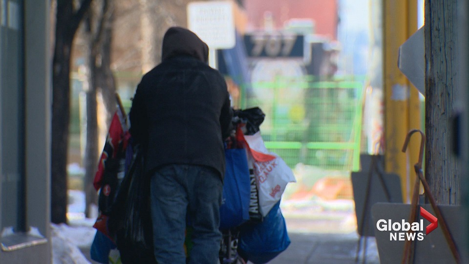 A person is seen pushing a cart in Calgary.