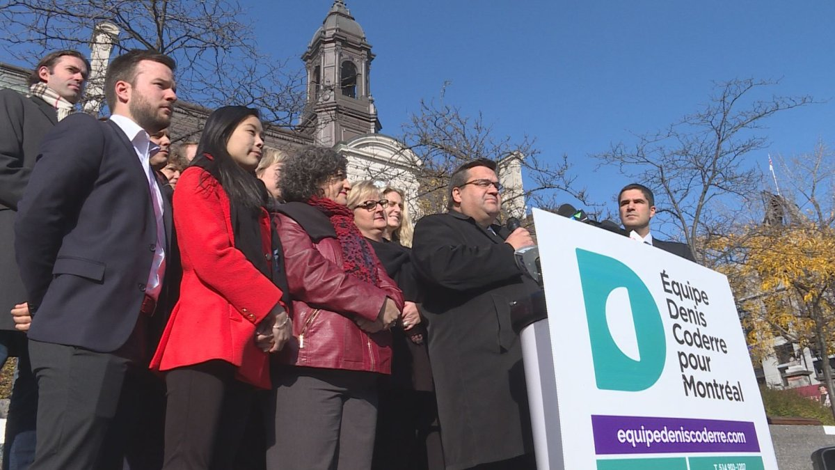 Denis Coderre speaks to reporters, flanked by members of his party, during a press conference outside Montreal City Hall on Saturday Nov. 4, 2017, on the last day of campaigning for the Montreal mayoral race.