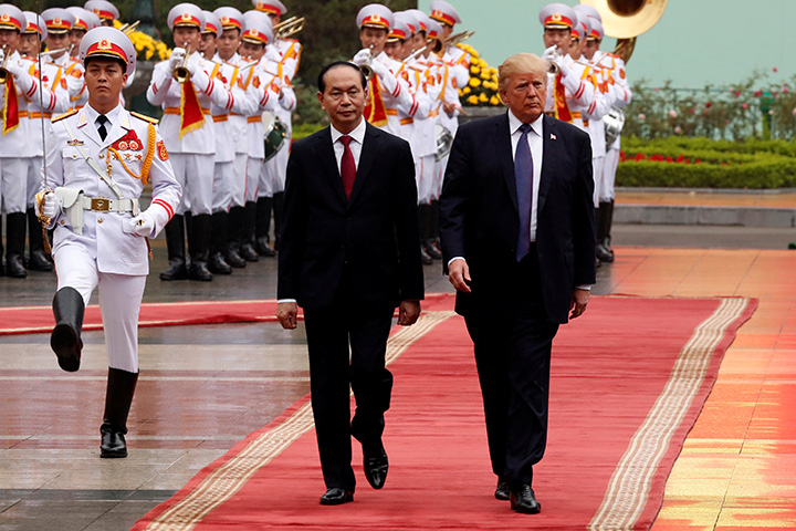 Vietnam's President Tran Dai Quang and U.S. President Donald Trump review troops before their bilateral meeting at the Presidential Palace in Hanoi, Vietnam November 12, 2017.