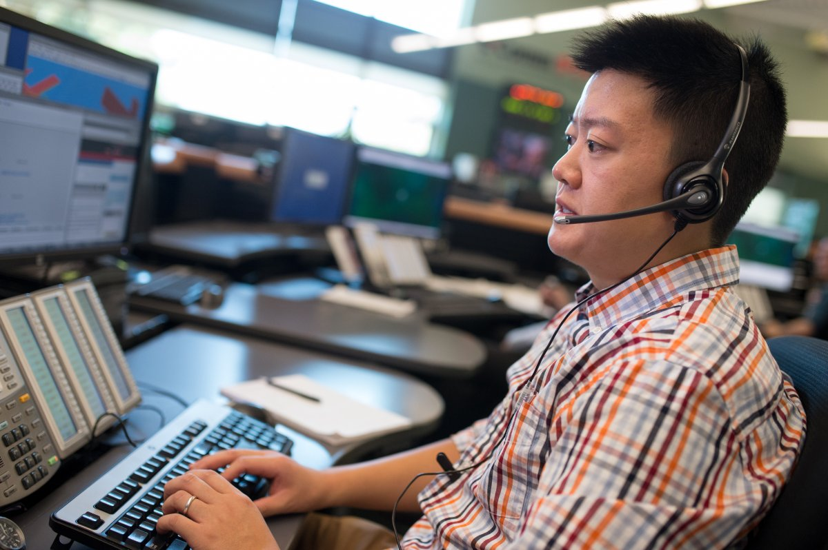 E-Comm's Jefferey Ching takes a call.