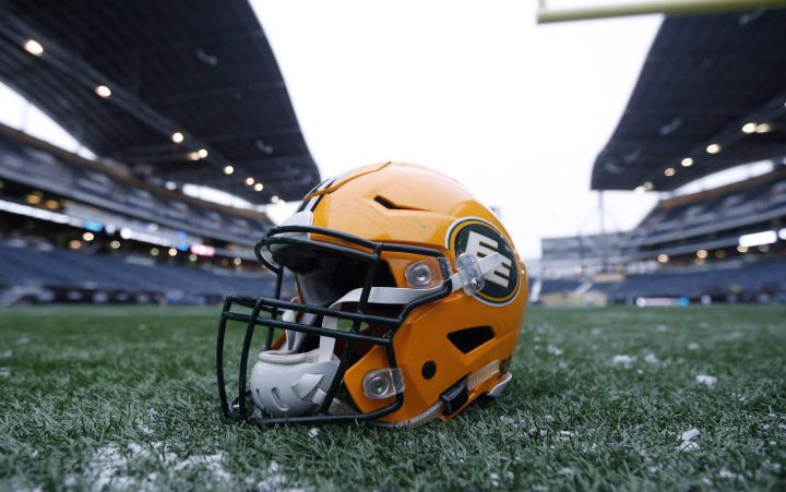 A helmet belonging to a Edmonton Eskimos player is seen on the field during a team practice session in Winnipeg on Wednesday, Nov. 25, 2015.