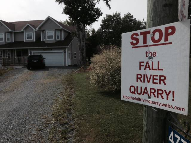 FILE - A sign protesting the Fall River quarry. On Friday, Nova Scotia announced it had dismissed three appeals against the project.