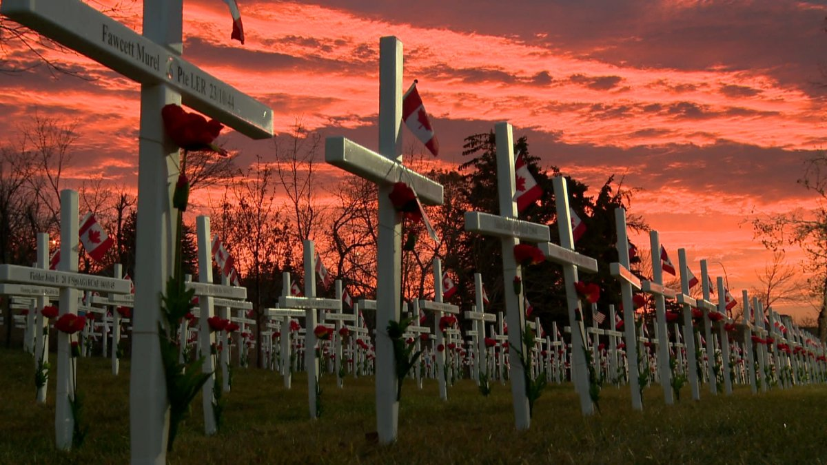 The sun rises over Calgary's Field of Crosses on Memorial Drive.