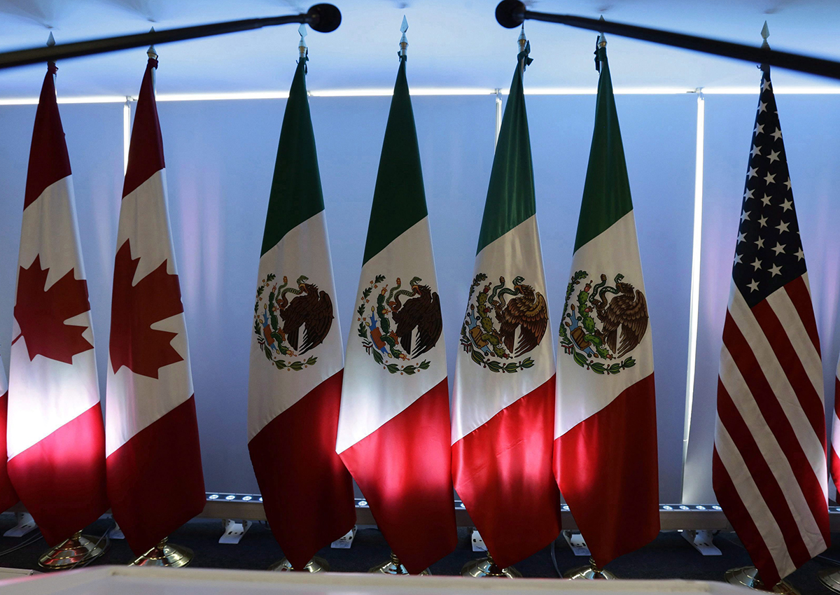 National flags representing Canada, Mexico, and the U.S. are lit by stage lights at the North American Free Trade Agreement, NAFTA, renegotiations, in Mexico City, on September 5, 2017.