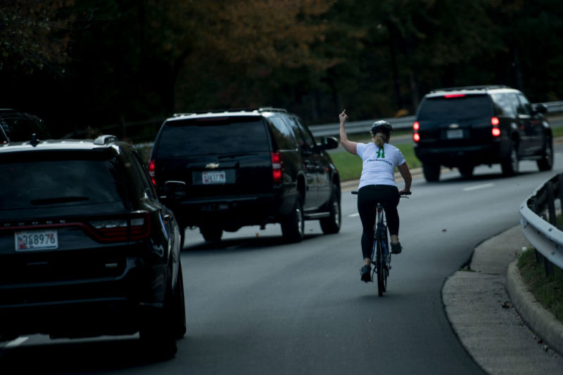 Juli Briskman was on her bicycle last month when Trump's motorcade drove by. A photo that quickly went viral shows her raising the middle finger of her left hand in defiance.