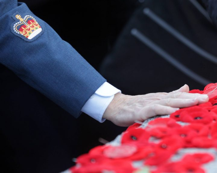 A man lays a poppy on the Tomb of the Unknown Soldier at a 2014 Remembrance Day ceremony in Ottawa, Canada. As Canadians celebrate the fallen today, let us not forget the sacrifices of those who came home bearing the physical and emotional scars of the horrors they witnessed.