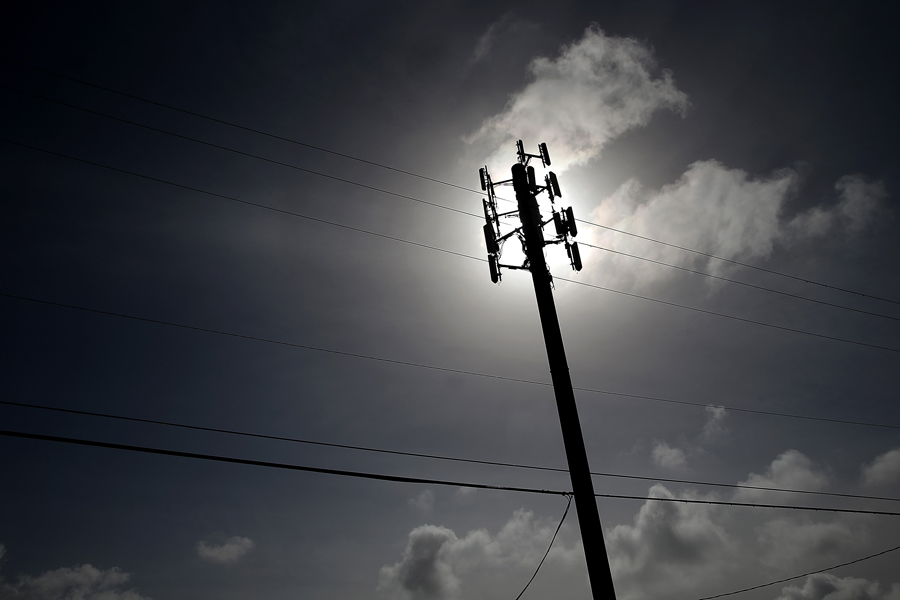 A cellular communication tower is seen in March 6, 2014 in Oakland, California.