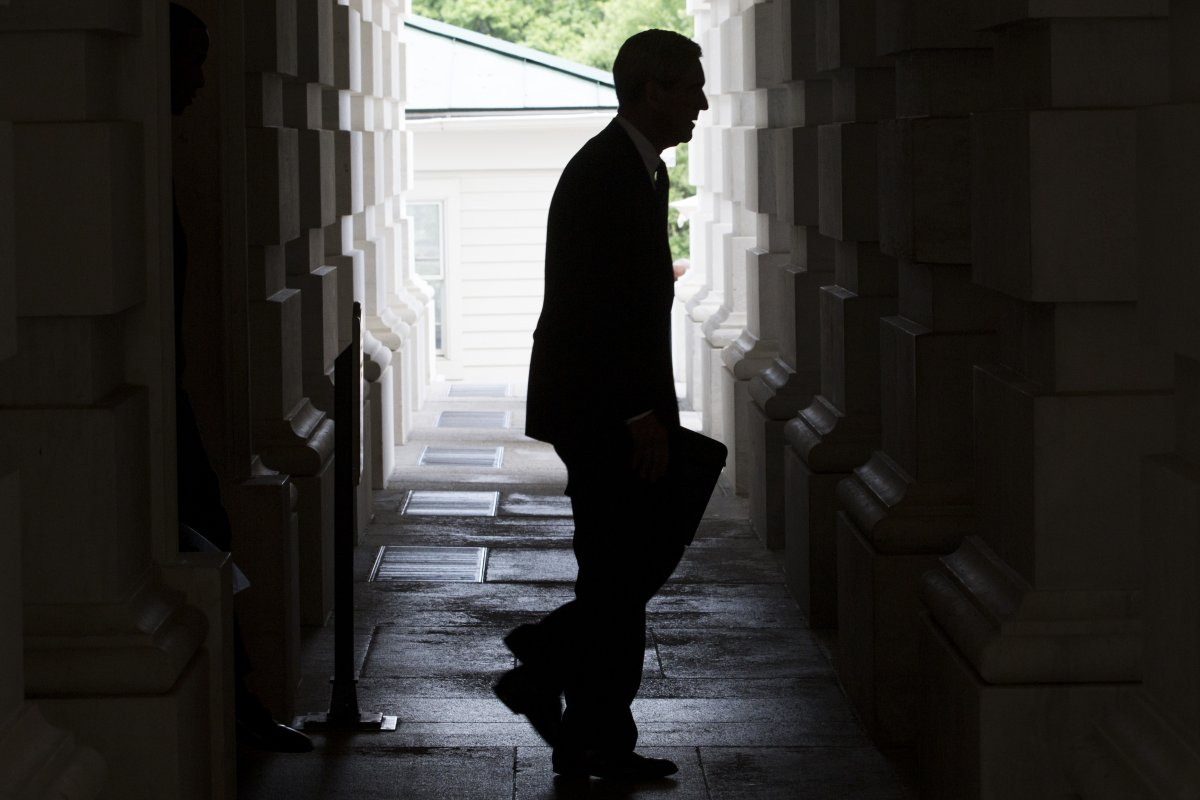 The silhouette of Robert Mueller is seen as he leaves the U.S. Capitol Building following a meeting with the Senate Judiciary Committee in Washington, D.C., U.S., on Tuesday, June 20, 2017.