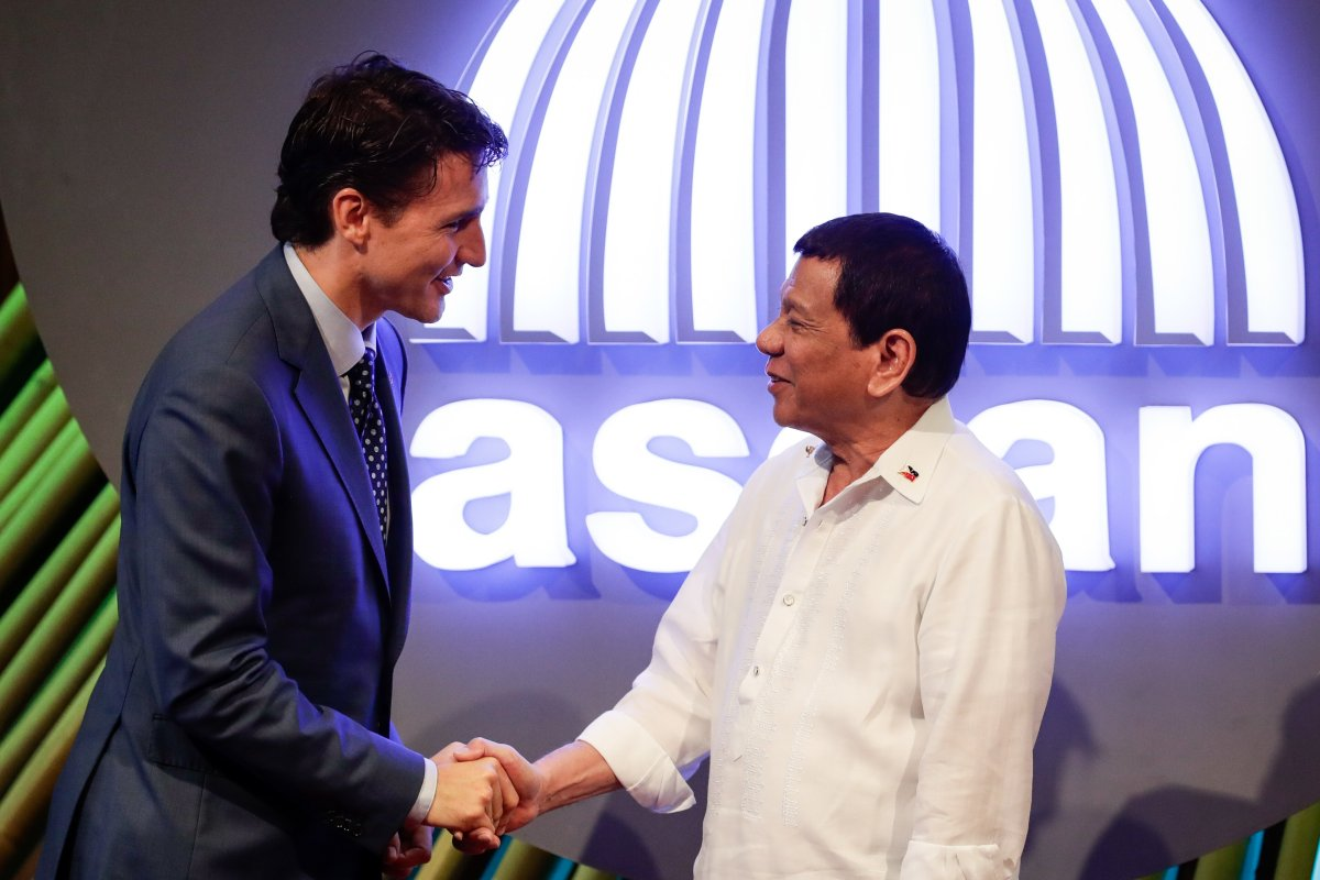 Prime Minister Justin Trudeau shakes hands with Philippine President Rodrigo Dutertebefore the opening ceremony of the 31st Association of Southeast Asian Nations (ASEAN) Summit in Manila on November 13, 2017. Duterte says he is cancelling a deal to buy helicopters from Canada, after the Trudeau government announced it would be subject to a human rights review.