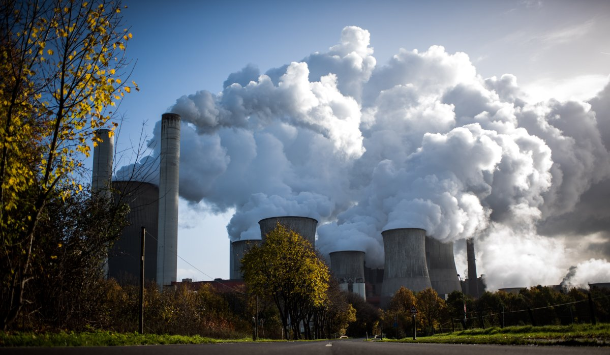 Steam rises from the Niederaussem coal-fired power plant operated by German utility RWE, which stands near open-pit coal mines that feed it with coal, on November 13, 2017 near Bergheim, Germany.