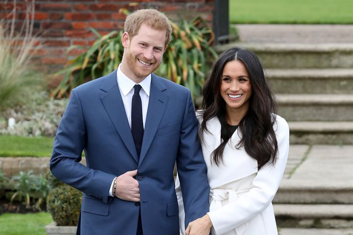 Prince Harry and Meghan Markle posing for photos in the Sunken Garden at Kensington Palace on Nov. 27.