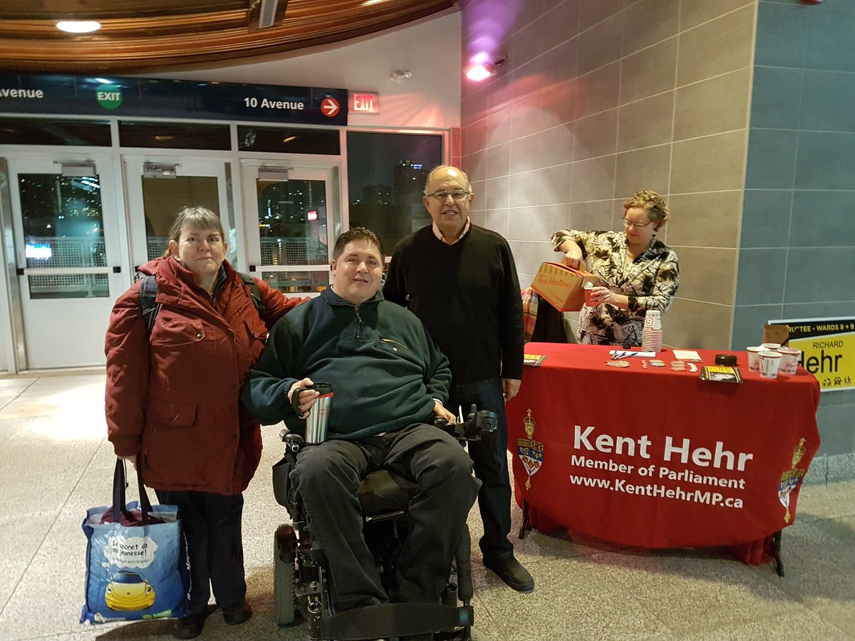 Liberal minister Kent Hehr is pictured here at an Oct. 13 campaign event  for his father's run at a Calgary LRT station. Conservative MPs say Hehr's use of parliamentary resources to support his father's election violate several federal rules.