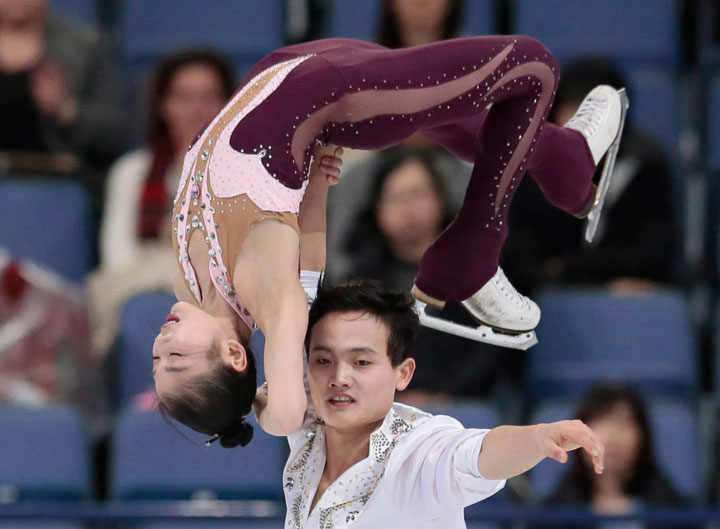 North Korea's Ryom Tae Ok and Kim Ju Sik skate their free program at the World figure skating championships in Helsinki, Finland, on Thursday, March 30, 2017. These two athletes will travel to the Olympics in February.