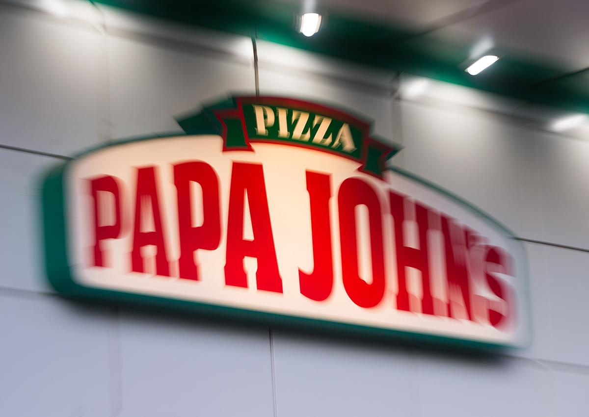 A sign at a Papa John's pizza restaurant.