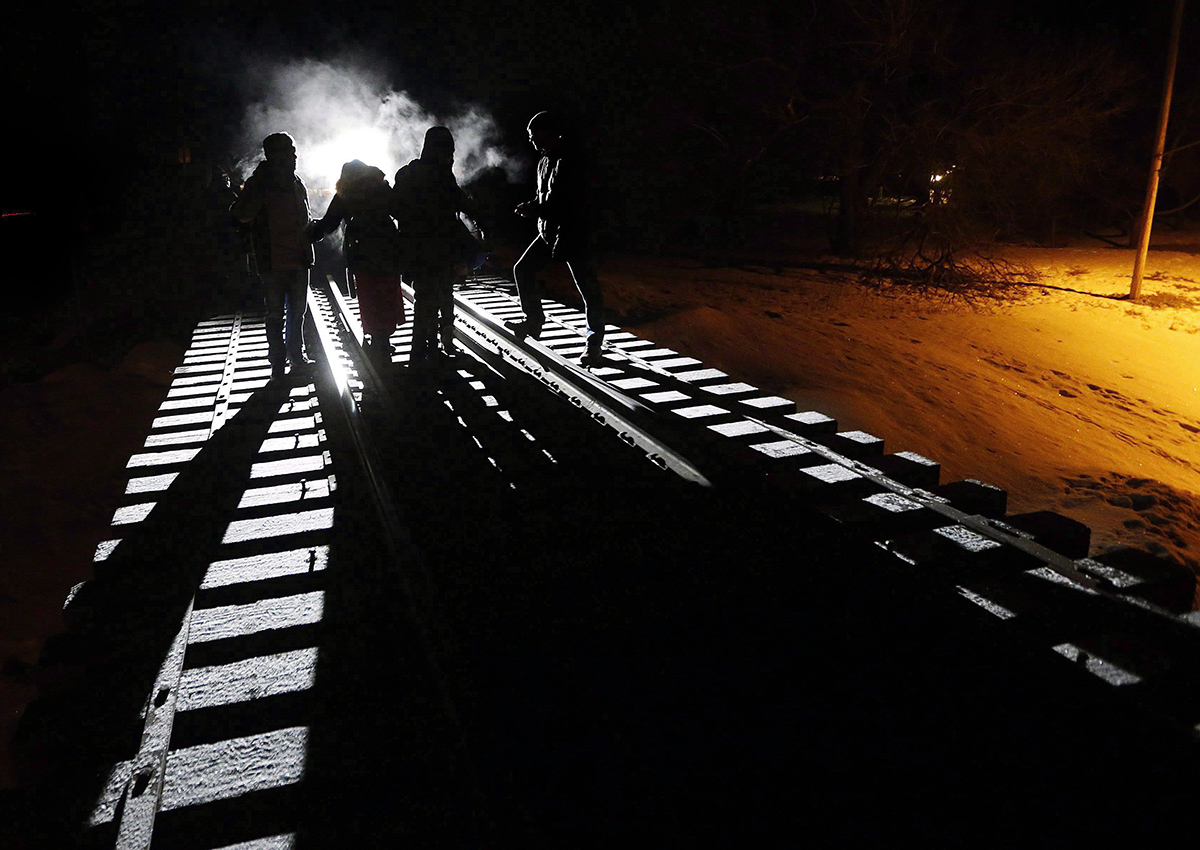 Early Sunday morning, February 26, 2017, eight migrants from Somalia cross into Canada illegally from the United States by walking down this train track into the town of Emerson, Man., .