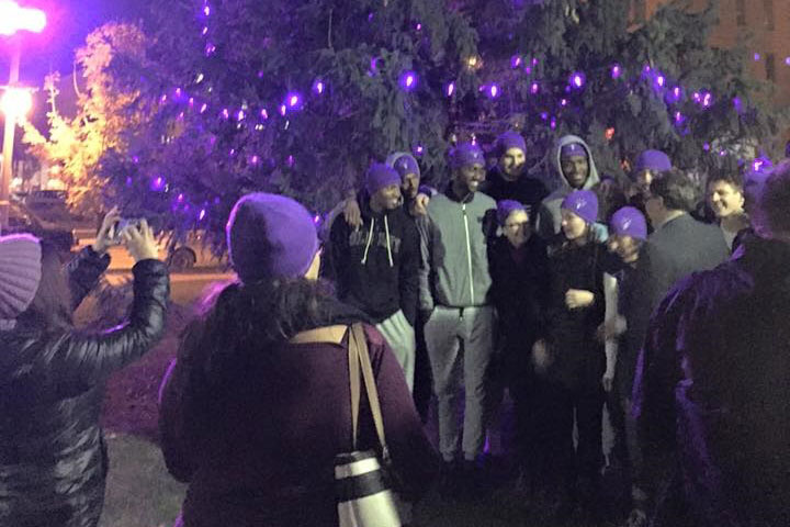 The Shine the Light on Woman Abuse campaign holds an event in Victoria Park in 2015.