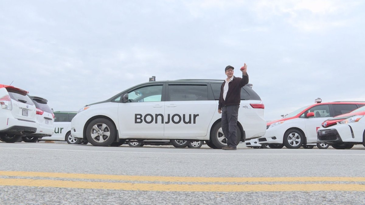 In this file photo, a Montreal taxi driver with his car painted with a new logo, at the Pierre Elliot Trudeau airport in Montreal. Hearings into Bill 17 to overhaul the taxi industry are ongoing in Quebec City. Monday, May 6, 2017.