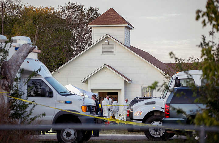 Investigators work at the scene of a deadly shooting at the First Baptist Church in Sutherland Springs, Texas, Sunday Nov. 5, 2017.