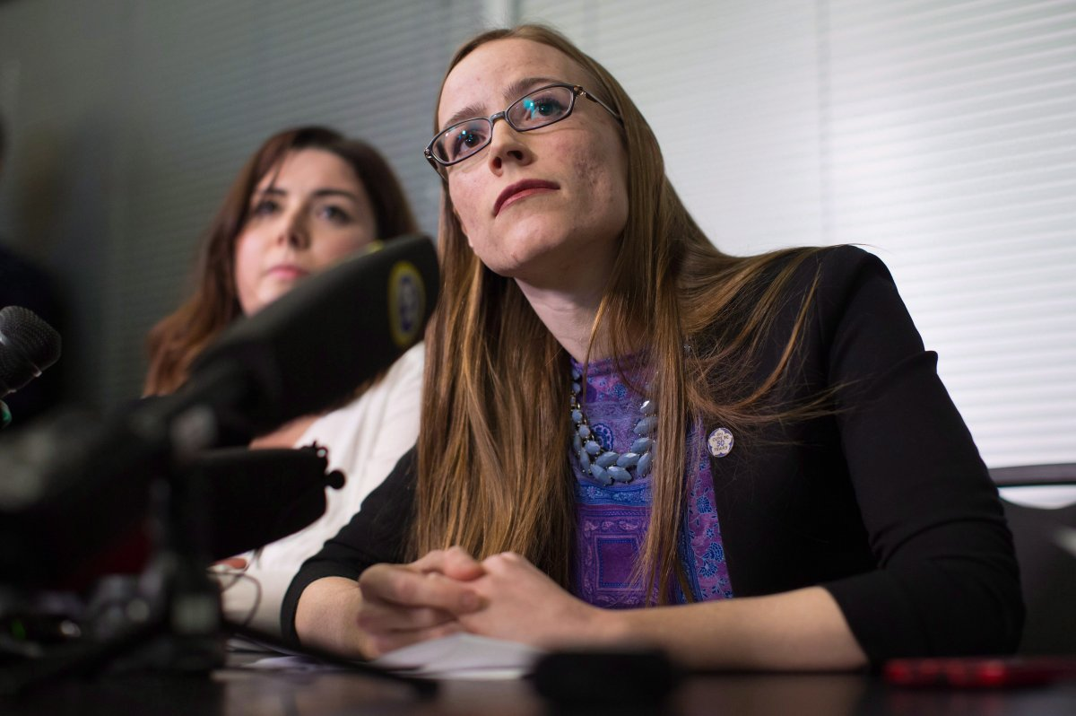 Former University of British Columbia students Glynnis Kirchmeier and Caitlin Cunningham, back, listen during a news conference at the university in Vancouver, B.C., on Sunday, November 22, 2015.